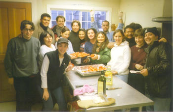 Latin American advocates prepare regional dishes for meeting participants on Latin America Night